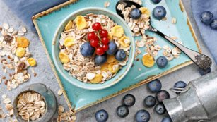 Directly Above Shot Of Oat Flakes With Berries In Bowl On Table